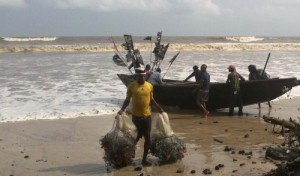 A-FISHERMAN-WITH-FISHING-NETS-SALVAGED-FROM-SUSPECTED-OIL-SPILL-AT-THE-QUA-IBOE-FIELDS-IN-AKWA-IBOM-ON-WEDNESDAY