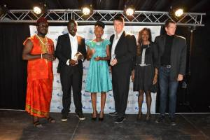 Odimegwu Onwumere in a group picture with other recipients and two of the judges
