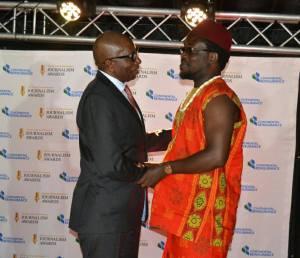 Odimegwu Onwumere with the Director-CEO of Continental Reinsurance PLC Dr Femi Oyetunji
