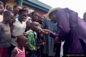 COLE WITH A CROSS SECTION OF CHILDREN AT THE CAMP